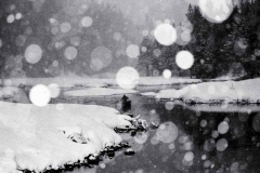 Lone Paddler in Snowstorm